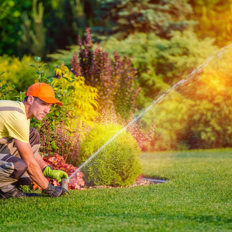 sprinkler tech working on an irrigation system